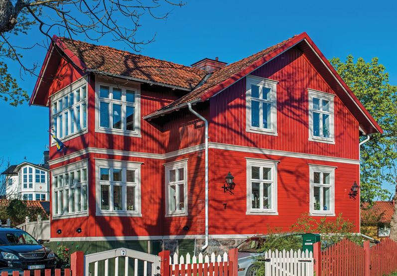 Принципы качественной окраски деревянного фасада